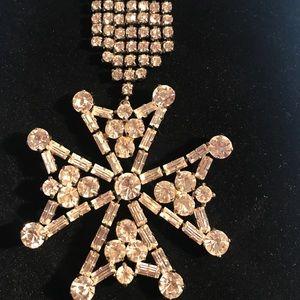 Crystal snowflake pin.